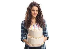 Teenage girl holding a birthday cake. Isolated on white background Stock Images