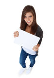 Teenage girl holding blank sign Royalty Free Stock Photos