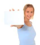 Teenage girl holding blank white card Stock Image