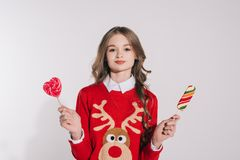 Teenage girl holding candies stock images
