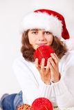 Teenage girl holding Christmas ball Stock Photo