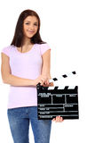 Teenage girl holding clapperboard Stock Photo