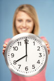 Teenage Girl Holding Clock Royalty Free Stock Photos