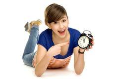 Teenage girl holding clock Royalty Free Stock Photo