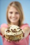 Teenage Girl Holding Cream Cake Stock Photo