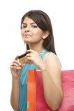 Teenage girl holding credit card Royalty Free Stock Photo