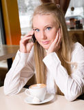 Teenage girl holding a cup of hot drink Royalty Free Stock Photos
