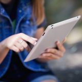 Teenage girl holding digital tablet computer close up. Royalty Free Stock Image