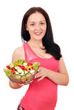 Teenage girl holding dish with salad Stock Photos