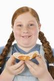 Teenage Girl Holding Donut Stock Images