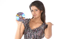 Teenage girl holding DVD Stock Images