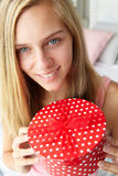 Teenage girl holding gift box Royalty Free Stock Images