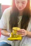 Teenage girl holding a glass of mango lassi Stock Photography