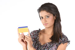 Teenage girl holding gold credit  card. Teenage Girl with gold color credit card over white background Royalty Free Stock Photo
