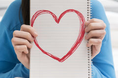 Teenage Girl Holding Heart in Notebook Royalty Free Stock Photos