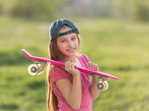Teenage girl holding her pink board Stock Image