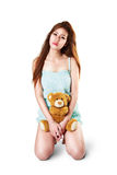 Teenage girl holding her teddybear. Isolated over white Royalty Free Stock Photo