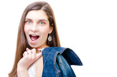 Teenage girl holding jacket and looking at camera on white copyspace background Stock Photography