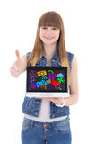 Teenage girl holding laptop with colorful media icons and applic. Ations and thumbs up isolated on white background Stock Photography