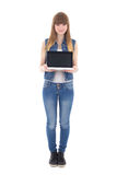 Teenage girl holding laptop with copyspace isolated on white Royalty Free Stock Photo