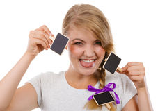 Teenage girl holding little school blackboards. School, education, learning concept. Teenage girl holding little school blackboards and ticking her tongue out royalty free stock images