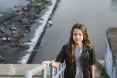 Girl near river Stock Photo