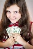 Teenage girl holding money Royalty Free Stock Photos