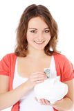Teenage girl holding piggy bank Stock Image