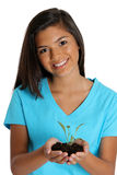 Teenage Girl Holding Plant Royalty Free Stock Images