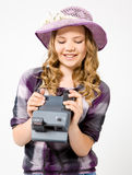 Teenage girl holding a polaroid camera Stock Photos
