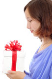 Teenage girl holding a present Royalty Free Stock Photo