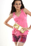 Teenage girl holding purse Royalty Free Stock Image