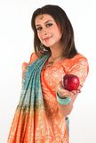 Teenage girl holding red apple Stock Photos