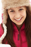 Teenage Girl Holding Snowball Wearing Fur Hat Royalty Free Stock Image