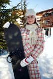 Teenage girl holding snowboard Royalty Free Stock Photography