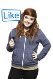 Teenage girl holding a social media sign smiling stock photography