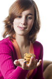 Teenage girl holding a stack of cookies Stock Photo