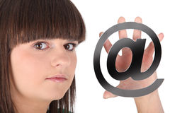 Teenage girl holding at symbol Stock Images