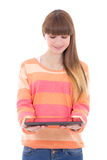 Teenage girl holding tablet computer isolated on white Royalty Free Stock Image