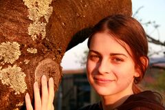Teenage Girl Holding The Tree Royalty Free Stock Photography