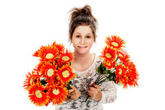 Teenage girl holding two bunches of fake flowers. Guilty looking teenage girl seeking forgiveness with two bunches of fake flowers. Studio shot on white Stock Photos