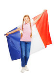 Teenage girl holding unfolded French flag behind Royalty Free Stock Images