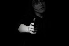 Teenage girl holding weapon at night time Royalty Free Stock Photography