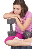 Teenage girl holding weight Stock Photo