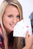 Teenage girl holding the winning card Royalty Free Stock Images
