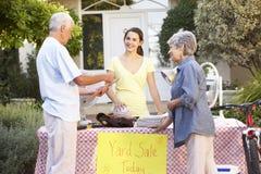 Teenage Girl Holding Yard Sale Royalty Free Stock Image