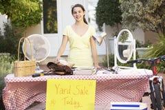 Teenage Girl Holding Yard Sale royalty free stock photo