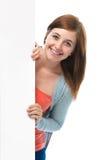 Teenage girl holds a blank board Stock Photos