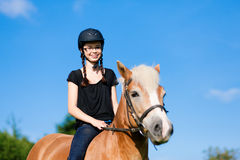 Teenage girl with horse Stock Photos