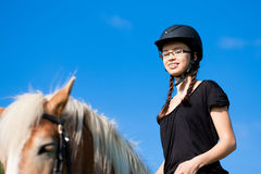 Teenage girl with horse Royalty Free Stock Photos